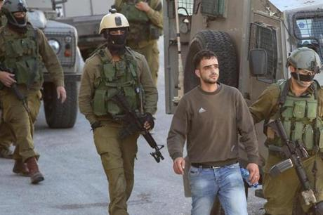 Israeli soldiers detained more than a dozen Palestinians in the West Bank on Saturday as they searched for three students from a Jewish seminary who disappeared late Thursday.